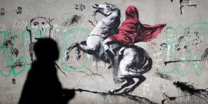 جدارية غرافيكية للفنان البريطاني بانكسي